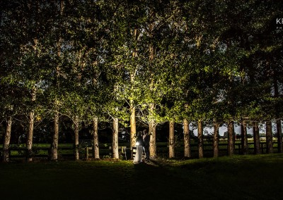 Couple at trees, night shot