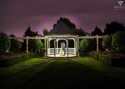 Couple in gazebo, night shot